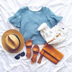 "A peek at what I packed for our getaway.. Headed to board the ship now!⚓️Thinking this adorable ruffled gingham top will be pretty darn precious in Italy..Ahhh, so excited!! (I literally packed everything thinking ""hmm, this will be cute against this backdrop.. Haha!). We woke up early this morning for cappuccinos & croissants in Barcelona, then strolled around THE cutest beach town along the coast! Follow me on snapchat (livvylandblog) for the behind the scenes scoop! Seriously.. So ..."