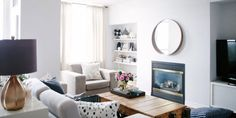 """Bold accents create cozy """"rooms"""" in this neutral, airy space."""