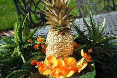 Gilded pineapple centerpiece for tropical summer parties!