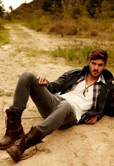 rugged men mens fashion.  I know it is hard for most of my client to imagine themselves in the outfit. But try to imagine him standing up and not laying fully clothed in the sand.  the layers on top are perfect, the pants fit well and the classic white tee and casual boots keep the look casual and young. #mensfashion #mensfashioncasual #mensfashionboots