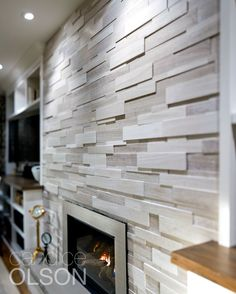 A beautiful wall of stacked-stone veneer. The stone says permanence, and the fire is welcoming; a universal symbol of home. A beautiful wall of stacked-stone veneer. The stone says permanence, and the fire is welcoming; a universal symbol of home. Modern Fireplace Tiles, Modern Stone Fireplace, Natural Stone Fireplaces, Fireplace Tile Surround, Home Fireplace, Fireplace Remodel, Fireplace Surrounds, Fireplace Design, Fireplace Ideas