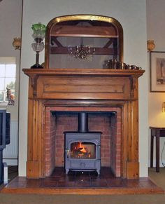 Bespoke oak mantel, brick chamber and Vision 500 wood stove fitted in Billericay, Essex 2007 by scarlett @ Design a fireplace