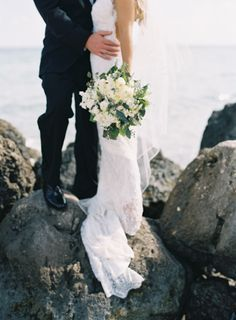 Lace wedding dresses and white flower bouquets.