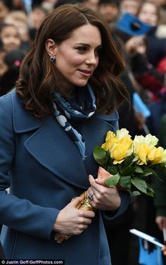 The Duchess was impeccably co-ordinated, wearing sapphire earrings and a patterned scarf t...