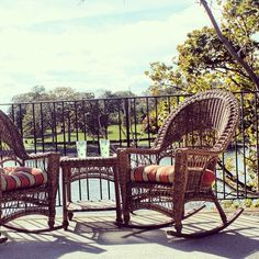 Outdoor #wicker #rockers and table set up on the balcony.