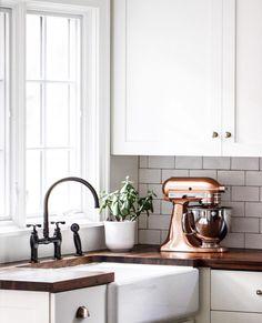 Copper Kitchen Aid stand mixer in a white kitchen