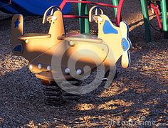 A wooden airplane on the playground for children to fly.