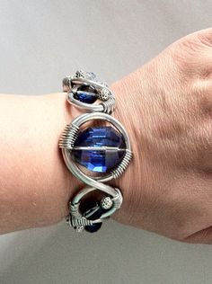 Deep Blue Crystal Spring Wire Looped Cuff by agapewirejewelry, $25.00