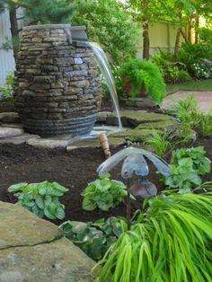Rock fountain - this looks like you can rock around a plastic wine barrow.