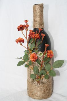 Black painted wine bottle with burlap and flower accents