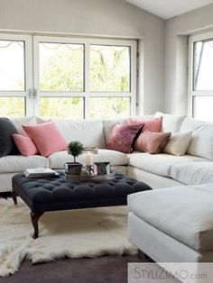 I love the feminine touch of the throw pillows and rug - I am on the fence about the coffee table, maybe if it wasn't so dark?