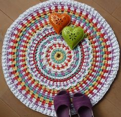 Colorful crochet rug- inspiration only- I should buy fleece yardage, turn it to yarn, then crochet cool rugs with it!!!