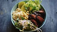 Black pepper and kaffir lime beef bowl with coconut rice and salad