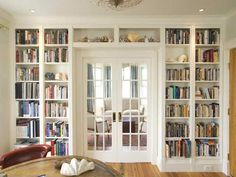 i really like this look for a library. wonder if we cld recreate it upstairs or if the layout is too awkward to make it work?
