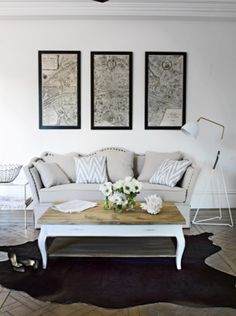 framed street maps from a favourite destination. Photo by Amanda Prior Wall Maps, Framed Maps, French Walls, Black And White Theme, Paris Apartments, Blue Rooms, Couch Pillows, Sofa, Warm Grey