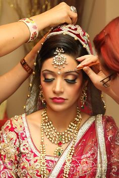 love this look. not sure about the small bindis above the eyebrows...