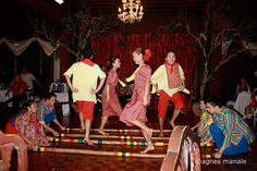 """The filipino folk dance called """"tinikling,"""" is a traditional filipino dance. It involves both men and women with sets of bamboo sticks sometimes crossed over each other. The bamboo sticks are hit together and on a ground usually in a rhythmic tune while the dancers step back and forth in between the spaces . Tinikling involves more props, feet movement and singing while Islamic dancing has many hand movements and very up-beat music."""