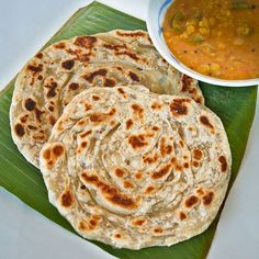 Crispy and fluffy homemade Roti Canai (Roti Paratha) with step-by-step instructions. Delicious eaten with dhal and chicken curry.