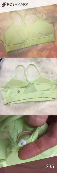 Neon Flow Y bra Lululemon No rip tag, size 4. Comes with pads. Excellent condition, just a tiny bit of fuzziness as shown in last pic. lululemon athletica Tops