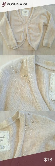 ABERCROMBIE & FITCH 50% lambs wool 20% viscose  10% rabbit hair 5% cashmere  15% nylon 38 bust  19 length  24 sleeve  Fasteners in middle, see photos  A few sequins loose but not really noticeable, see photos  Check your own measurements Abercrombie & Fitch Sweaters