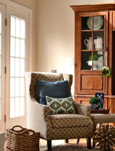 Styling the corner of a room by layering color, pattern and accessories
