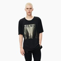 A box fit t-shirt with a metallic logo graphic film print.