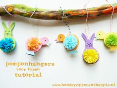 100%Heppie: Pompon easter hangers - tutorial in Dutch, but I guess you can work it out by looking at the pictures pretty easily