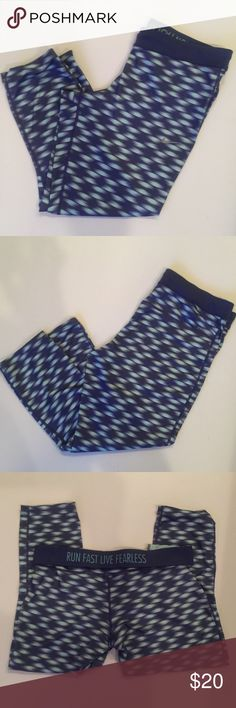 Nike Capri Pants Nike Capri pants. In great condition. Great for running. | Size L Womens| Purple and Turquoise Nike Pants Leggings