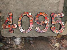 Custom Made Stained Glass Mosaic House Numbers - Your Color Choice  (These are in shades of reds, oranges & tans). $24.00, via Etsy.