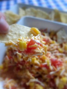 1 (11oz) can corn, drained  1 tomato, diced  2 cups cheddar cheese, shredded  1 (4oz) can black olives (optional)  1 cup Italian dressing    Combine all ingredients in medium bowl. Refrigerate 2 hours up to overnight. Serve with tortilla chips or Fritos
