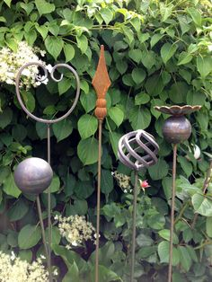 Metal Art Plant Supports - Home. I am using old curtain rods in my garden. They are functional and artistic.