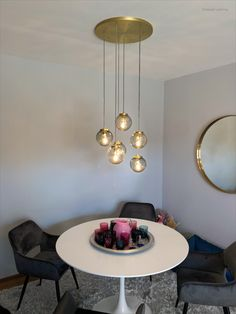 A beautiful small glass globe lamp above a dining table. This absolutely delights any apartment and creates a cosy atmosphere for a dinner for two.  Glass Globe mouthblown by Glashütte Comploj in Vienna, Metalwork done by Dotzauer Lighting in Vienna too. Finish a brushed brass. Glass in shade of grey. Electrical wires in light gray fabric to perfectly suit the glass. Bespoke designs possible on request. Globe Lamps, Dining Table, Table Lamp, Gray Fabric, Electrical Wiring, Bespoke Design, Shades Of Grey, Vienna, Metal Working