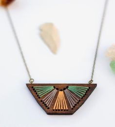 Embroidered Wood Pendant made by Savvie Design Co. Made with reclaimed poplar wood.