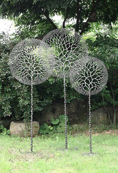 this a metal sculpture. i find it interesting because they look like giant dandelions.