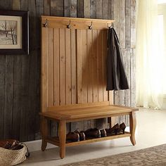 Organize the clutter in your entryway while adding some rustic flair to your home with this Sadona Pine Hall Tree. You'll wonder how you managed to get by without it!            Hall tree measures 40L x 18W x 64H in.          Crafted of wood          Pine finish          Features four (4) hooks for clothes          Features one (1) shoe rack and one (1) open space          Some assembly required          Not intended for commercial use          Care: Dust with a soft, dry cloth.          T Entryway Furniture, Entryway Bench, Diy Furniture, Modular Furniture, Furniture Plans, Entryway Ideas, Retro Furniture, Hall Tree Bench, Hall Trees