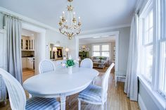 I love everything about this.  The white table.  The fact that the house appears old.  The curtain over the archwway.  The buffalo check (of course) The gray walls, the chandelier.  Makes me want to redo my yellow living/dining rooms.