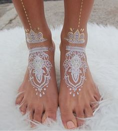 Stunning White Henna Tattoos Look Like Lace Draped Over Skin - My Modern Met -- idea for tangle drawing