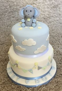Baby Shower Cake For A Baby Boy .with Bunting ,clouds And A Fondant Elephant