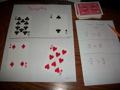 This math card game is called Simplify. The goal of the game is to correctly simplify the fraction. I played it where you also had to put it in order from least to greatest.   Education.com (n.d.). Simplify It!: A Fraction Card Game | Activity | Education.com. Retrieved May 22, 2013, from http://www.education.com/activity/article/simplest-form/