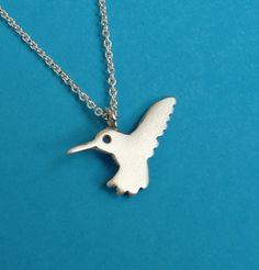 Small sterling silver hummingbird charm necklace. The pendant is 1.7cm/0,7 wide and 1cm/0.5 tall. You can choose between a pendant with NO chain, a