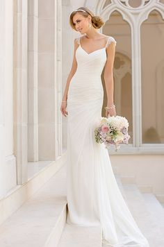 This sheath wedding dress features whispery lace shoulder straps and figure-flattering asymmetrical ruching throughout the bodice and hips. Stella York, Fall 2014