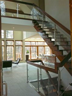 glass railing w/ stainless steel and wood frame