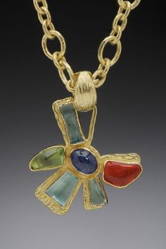 Flower Power Pendant Flower Power Pendant set on 18K gold has Aquamarine, Peridot, Mexican jelly opal and Tourmaline stones; on a 18K chain.
