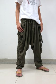 I would like to introduce our first collection, I got inspired by sport activities such as parkour,free running, street dance etc. the design is focus on comfortable, simple but cool design. This is going to be your fav sport pants ever. Features: - Elastic waist band - Two front pockets - Drop crotch - Pull them up mid- calf for 3/4 length which is awesome Approx. measurement Waist: 24- 38 Hips: up to 41 Total Length: 39 Sizing: One size fits most. UNISEX pants Shipment Worldwide s...