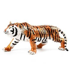 """Large Prowling Tiger Trinket Item No. KB00491A01 $228.89 Roar for this large tiger trinket! He stands 4"" tall and is about 9 1/2"" long! Sturdy and strong, this tiger trinket is decorated with delicate Swarovski crystals. Fair amount of space inside for your small treasures! This product is made from a pewter base and then hand-painted with thick enamel. T"