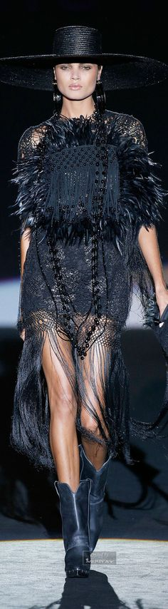 Roberto Verino Spring-summer 2015 Cowboy boots and fringe she struts it with confidence.