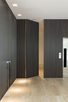 """Retrofit of the Silver Park Condominium is a project designed by Diego Revollo. """"Renovating this residencial building of the we created a glamorous atmosphere in a modern style"""" Photography by Diego Revollo Home Interior Design, Interior Architecture, Hidden Rooms, Hidden Closet, Door Detail, Secret Rooms, Wall Cladding, Internal Doors, Office Interiors"""