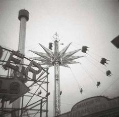 Holga photography by Angela Petsis. Toy camera photography. Black and white photography. Film. Dreamy. Carnival rides. Blur. dream. Mystery.