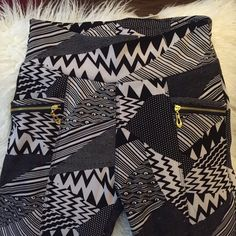 BLACK & WHITE GRAPHIC PRINT LEGGINGS- new! Black and white graphic print leggings. Has 2 pockets. Machine washable. 94% polyester, 6% spandex. Label says L/XL, runs small so fits more like a L. Black fleece lined makes these very soft and comfortable.  Brand new with tags.  sorry no trades  no lowball offers please bundle & save Indero Pants Leggings