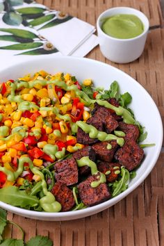 Savory marinated tofu is baked, oil-free, and along with sweet corn relish, arugula, and creamy avocado dressing it's the best vegan tofu bowl ever! Vegan, gluten-free (if you use Tamari), and oil-free. Vegan Bowl Recipes, Vegan Foods, Salad Recipes, Healthy Recipes, What Is Tofu, Creamy Avocado Dressing, Corn Relish, Marinated Tofu, Baked Tofu